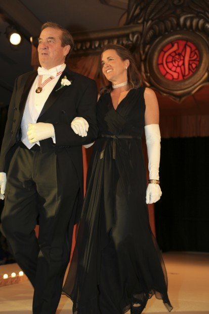 Lady of Honor Mrs. Timothy O'Toole George, escorted by Sidney Holthaus