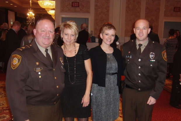 Sgt. James and Veronica Schrand, Rebecca and officer Brandon Feazel
