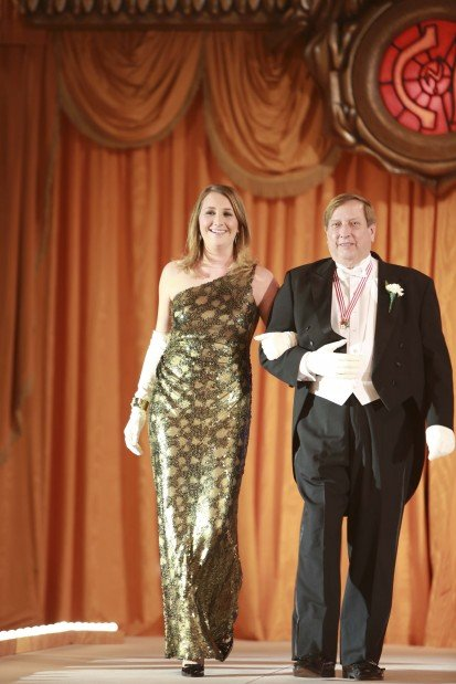 Former Queen Miss Melissa Brenton Howe, escorted by Nelson Howe