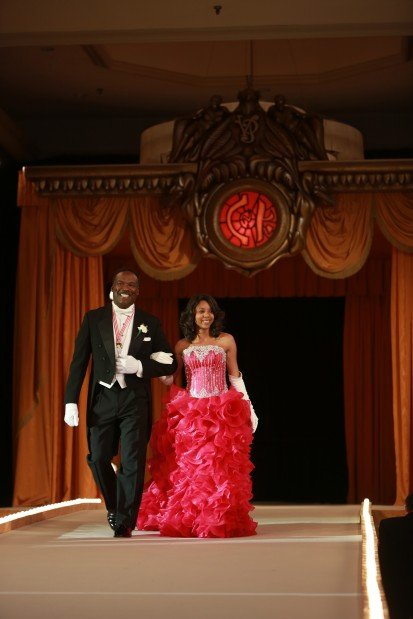 Kamron Nicole Taylor, daughter of Mr. and Mrs. Kelvin Taylor Sr., escorted by James Williams Jr.