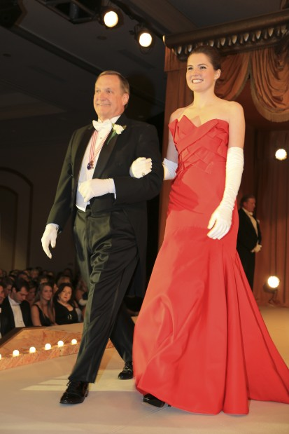 Caroline Frances Rouse, daughter of Dr. and Mrs. Andrew Rouse, escorted by John Rouse