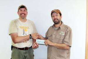 """<p>Joel Taylor from Safe Hunters of Tomorrow presents Tom Schenk, Associate of the Wounded Warriors In Action Foundation, with a check to help fund the upcoming WI Musky On A Fly outing which is on October 5-8. If you are interested in helping fund this Rusk County event for combat wounded, purple heart recipients, please visit www.wwiaf.org or contact Tom Schenk at 715-312-0509. Please write """"WI Musky On A Fly"""" in the comment section of the donation form.</p>"""