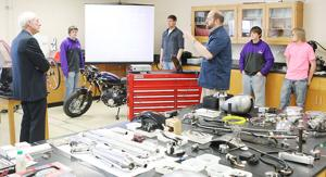 <p>Ladysmith High School science teacher Brian Groothousen (foreground center) explains how students are learning by totally restoring motorcycles. Students are currently on their second rebuild project. The presentation included  comments by Brandon Boggs (l. to r.), David Cooley, Cody Rutter and Dylan Skogstad.</p>