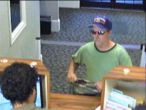Police seek suspect in city bank robbery