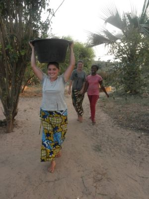 Mission Intern from Denver takes pig project to West Africa