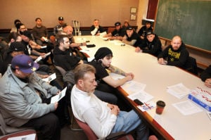 Tattoo artists meet with health officer