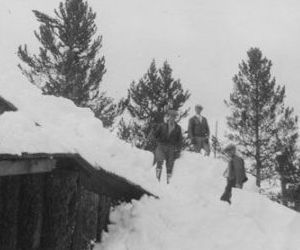 <p>The snow was deep enough at the time this photo was taken that several members of the Bearcats climbed onto the roof of their cabin.</p>