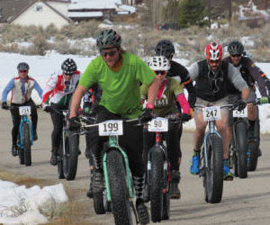 """<p>Eric Cutlip leads Becca Katz and Michael Bordogna as the race begins. The riders are participating in Cloud City Wheelers' last bike race of the winter season. Coined the """"East Side Epic,"""" the event takes riders through Lake County's mining district.</p>"""