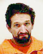 Slaying suspect faces drug charges