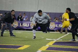 <p>LSU offensive lineman La'el Collins (70) runs a drill on Friday, Mar. 27 2015 on LSU football Pro Day at the football operations indoor facility.</p>