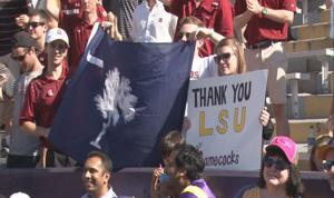 """<p>Gamecock fans inside Death Valley show their thankfulness for Tiger fans' hospitality with a """"Thank You LSU"""" sign.</p>"""