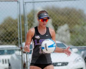 <p>LSU freshman Mandi Orellana (15) gets ready to serve during the Tigers' 4-1 defeat against Florida International on Saturday, March 21, 2015 at Mango's Beach Volleyball Club.</p>