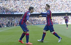 <p>FC Barcelona's Luis Suarez, left, celebrates after scoring against Valencia with his teammate Lionel Messi during a Spanish La Liga soccer match at the Camp Nou stadium in Barcelona, Spain, Saturday, April 18, 2015. (AP Photo/Manu Fernandez)</p>