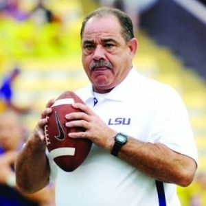 <p>LSU defensive coordinator John Chavis throws a ball during warm-up for the Sept. 29, 2012, game against Towson. Chavis' defense often ranks among top lines.</p>