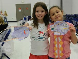 Visiting artist helps students create origami fish