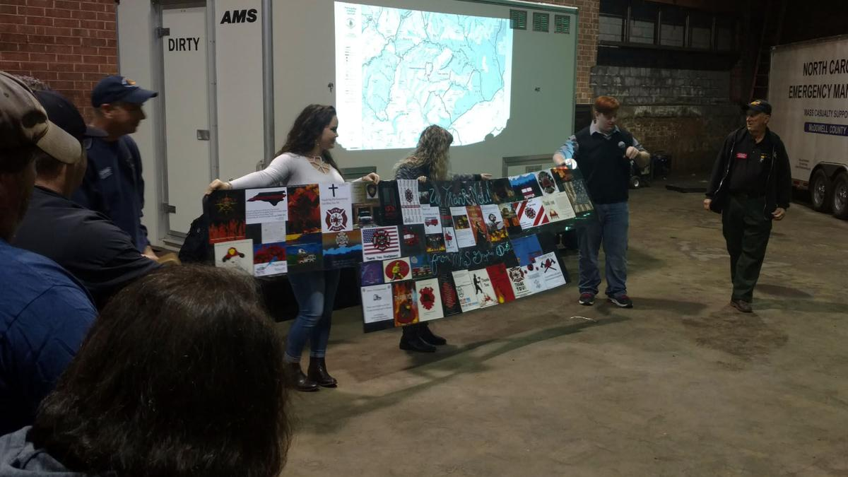 Students present banner to Clear Creek Fire workers