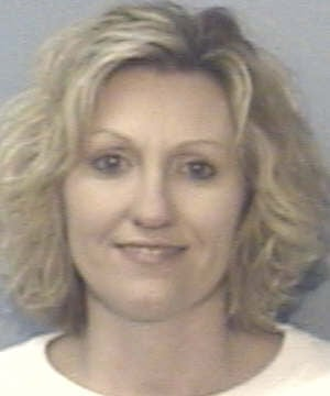 Woman accused of embezzling from Marion orthodontist surrenders