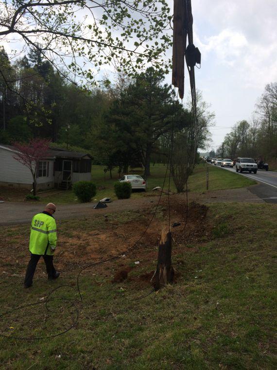 Two hurt when car hits utility pole