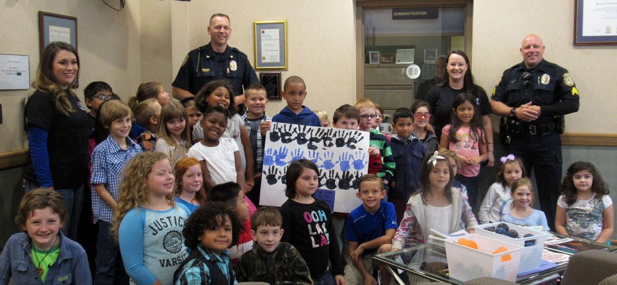 Connecting in the community: McDowell students surprise Marion P.D. with gifts