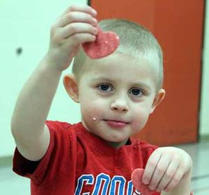 Drake Thole, 4, Aitkin, shows off his hard work at the play dough table.