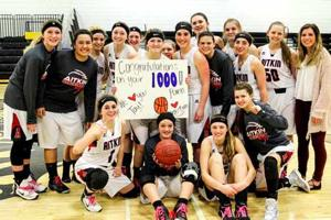 Taylor Ehnstrom and her teammates celebrated Ehnstrom's 1,000th career point during the Feb. 14 contest at Onamia.