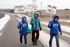 Local members of LIFE Runners protested abortion on Jan 22.