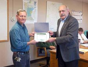 Bill Thompson, building and grounds supervisor in administration/building maintenance department, was recognized for 30 years of service.