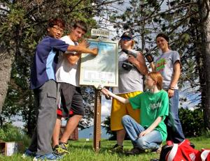 4-H members with trail sign