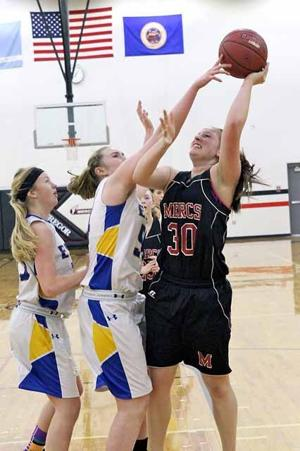 Danelle DeMenge's aggressive play in the post helped the Mercs defeat Chisholm.