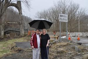 <p>Nolan St. residents  Buddy and Patricia Whitt, above, say the closure of the Nolan Toll Bridge is not simply a matter of lost convenience for the 22 families living in that neighborhood. They say the bridge's closure represents a clear and present danger when a train blocks the only exit from their homes. Below, on Tuesday, about 100 area residents from both sides of the Tug River gathered at the bridge to bring attention to the problem.</p>