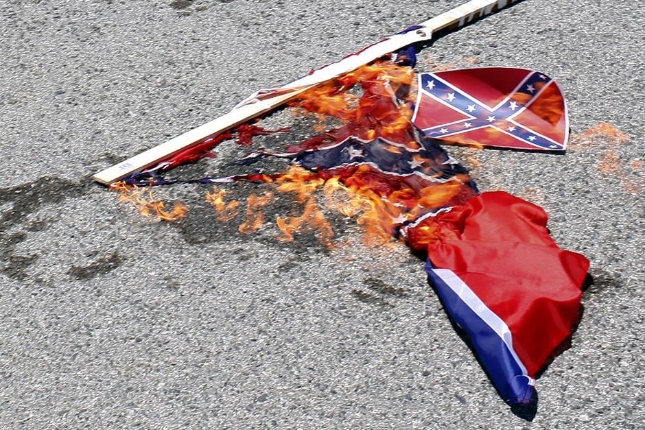 Peace Protesters Burn A Confederate Flag In Monterey