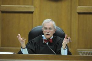 Priest case will proceed more privately, judge admonishes attorneys for talking.