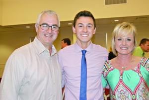Outstanding senior Jacob Livingston is flanked by his mom and dad, Bill and Julie Livingston