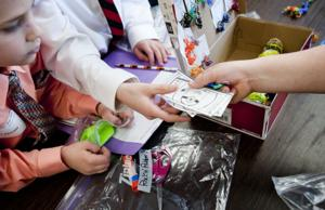 Elementary students learn economics at Market Day