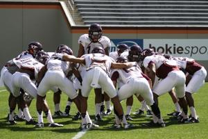 Virginia Tech defensive back huddle