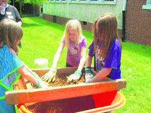 Boonsboro Elementary students excavate clay figures