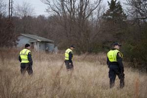 Officers search river for missing teenager