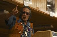 <p>Second Traditional Chief Trimble Gilbert gives the opening prayer during the Tanana Chiefs Conference Centennial Celebration at the Chief David Salmon Tribal Hall on Monday, July 6, 2015.</p>