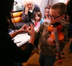 Kids learn about musical instruments after Sweet Plantain performance