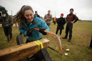 Sports festival participants test their lumberjack skills