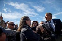 <p>President Barack Obama greets visitors after arriving at Elmendorf Air Force Base, Monday, Aug. 31, 2015, in Anchorage, Alaska. Obama opens a historic three-day trip to Alaska aimed at showing solidarity with a state often overlooked by Washington, while using its glorious but changing landscape as an urgent call to action on climate change. (AP Photo/Andrew Harnik)</p>