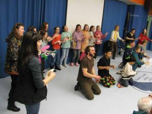 Pearl Creek Elementary School's kuspuk club celebrates its colorful creations