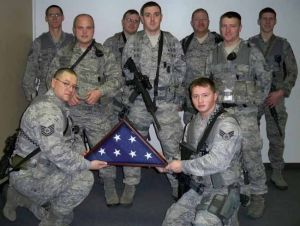 Alaska soldiers replace Kansas woman's Purple Heart, flag damaged in explosion