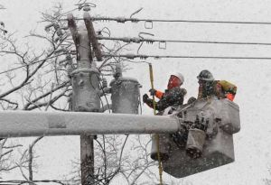 Fairbanks IBEW linemen join Northeast repair work crews