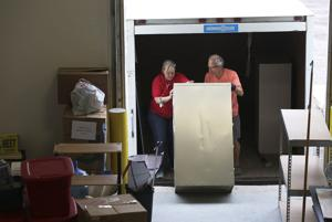 Volunteers help Red Cross move to its new home