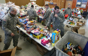 Fort Wainwright troops deliver bounty of toys to Santa's Clearing House