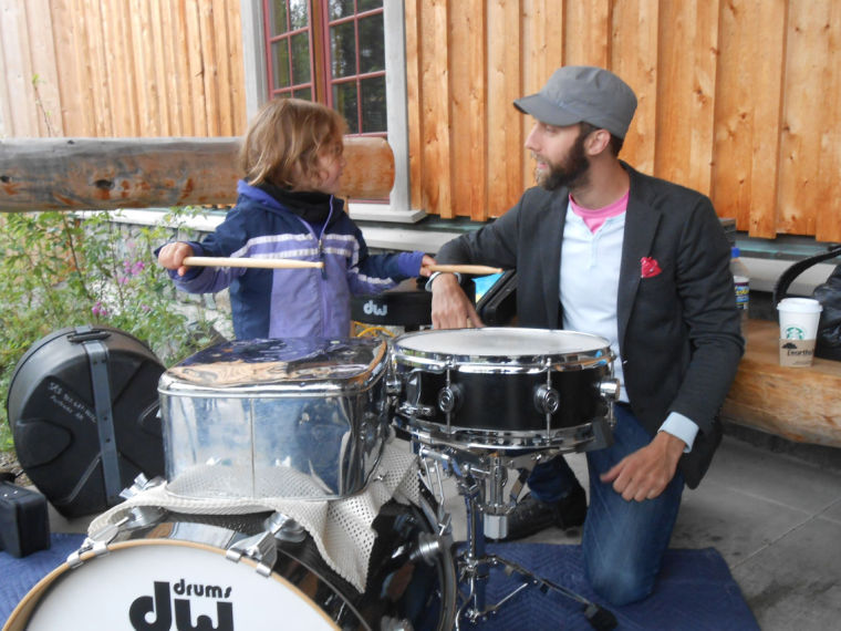 <p>Fairbanksan Riley Griffeth, 4, gives drums a try under the watchful eye of percussionist Owen Weaver, after a Concert Black performance at the Denali Visitor Center. This was part of the Denali Music Festival, outreach from Fairbanks Summer Arts Festival. </p>