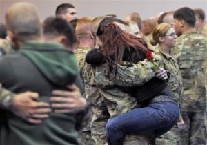 Family, friends greet returning soldiers at Anchorage base