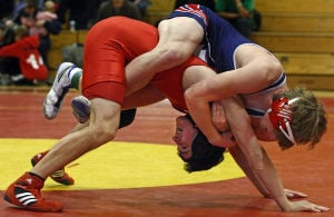 Visiting wrestling teams pull out dual-meet victories