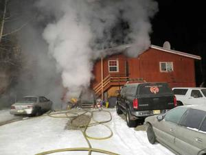 North Pole fire displaces families; dog dies